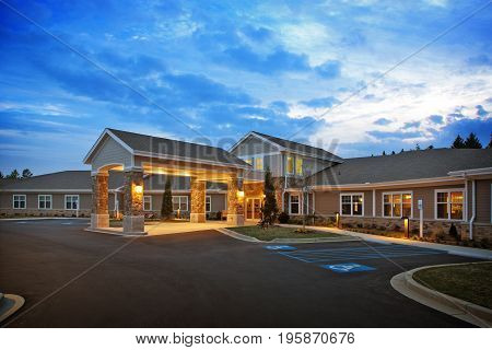 Generic Medical Retirement home dentist building exterior with drive in entrance