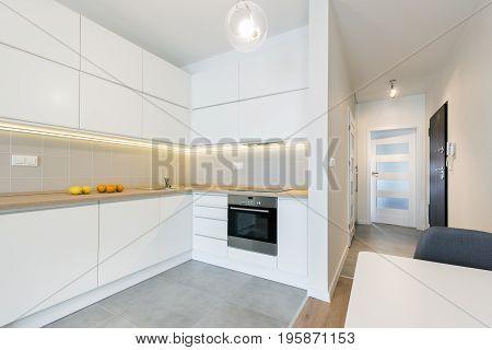 Modern kitchen interior design in white finishing in small apartment