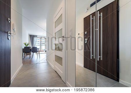 Corridor with tiles floor in modern apartment