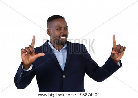 Smiling businessman forming a finger frame against white background