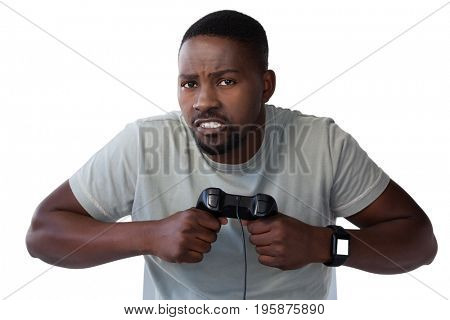 Close-up of frustrated man holding joystick against white background