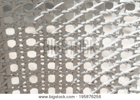 White wicker backrest. Close up texture. Chair.