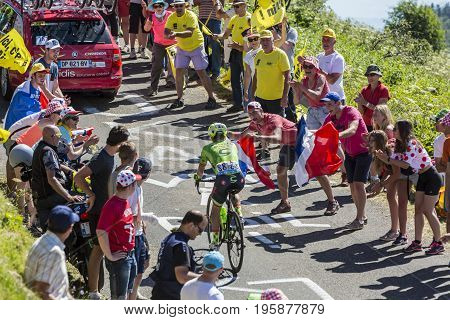 Col du Grand ColombierFrance - July 17 2016: The Dutch cyclist Tom Jelte Slagter of Cannondale-Drapac Team riding on the road to Col du Grand Colombier in Jura Mountains during the stage 15 of Tour de France 2016.
