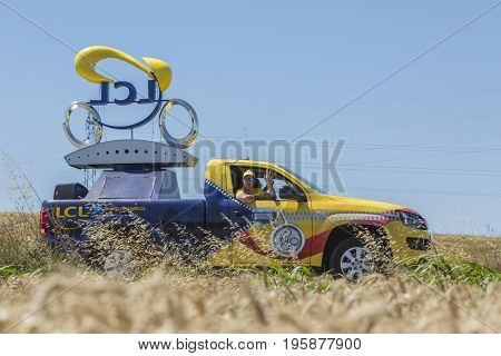 Saint-Quentin-Fallavier France - July 16 2016: LCL vehicle during the passing of Publicity Caravan in a wheat plain in the stage 14 of Tour de France 2016. LCL was the largest bank in France and sponsored continuosly the TDF during more then 30 years.