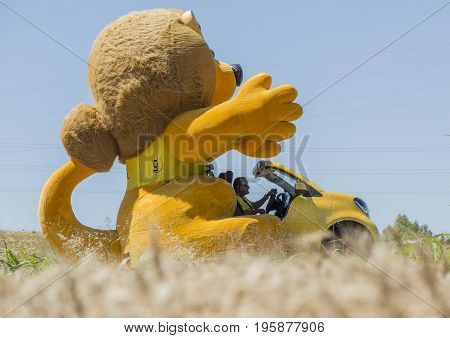 Saint-Quentin-FallavierFrance - July 16 2016: LCL traditional lion mascot during the passing of Publicity Caravan in a wheat plain in the stage 14 of Tour de France 2016. LCL was the largest bank in France and sponsored continuosly the TDF during more the