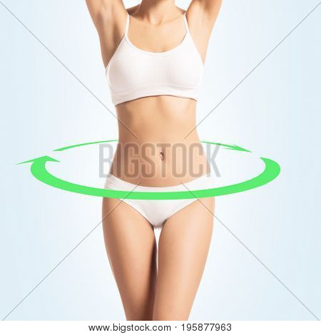 Young, sporty, fit and beautiful girl isolated on white. Food, healthy eating, dieting and nutrition concept.