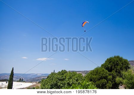 Paraglider flying from the Pamukkale park.Turkey.July 2017