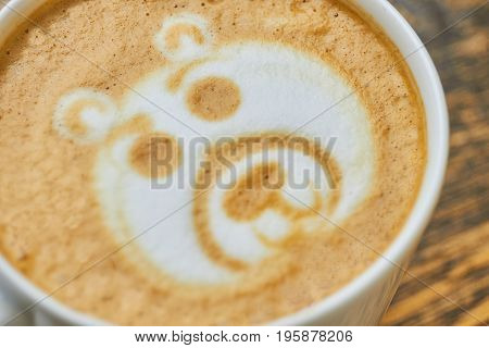 Latte art bear. Coffee foam close up.