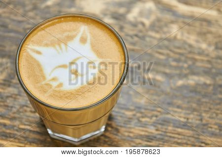 Cat coffee art. Latte glass with foam.