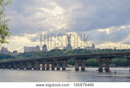 Summer cloudy day view of the bridge over the Dnipro River in the city of Kiev in Ukraine