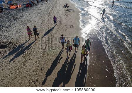 KOLOBRZEG, WEST POMERANIAN / POLAND: Walk the sea beach at sunset