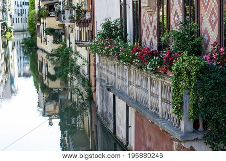 View of the canal in Padua province in Italy with a green area