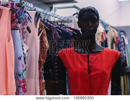 Summer female dress hanging on a mannequin in a women's clothing store