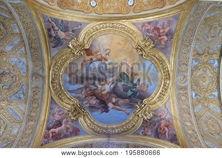 ROME, ITALY - SEPTEMBER 02: The fresco of virtues of Hope and Truth on the little cupola of side nave in Basilica dei Santi Ambrogio e Carlo al Corso by Pio Paolini, Rome, Italy on September 02, 2016.