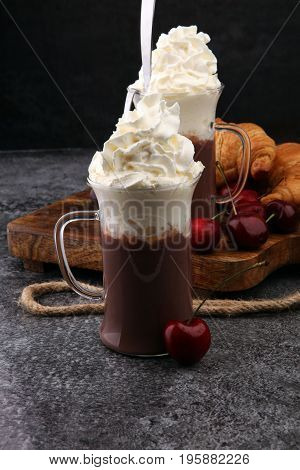 Iced Coffee With Whipped Cream In Tall Glass And Fresh Croissant