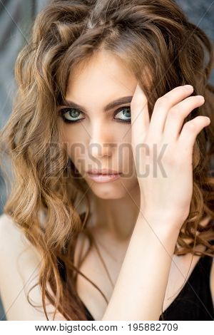 Face of beautiful brunette close-up. Beautiful, young brunette. Without filters. Natural color.