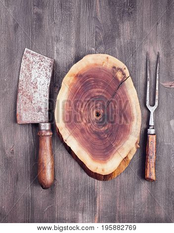 Wooden cut with cleaver knife and fork. Food concept background