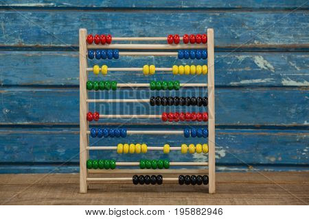 Abbacus game against blue wooden background