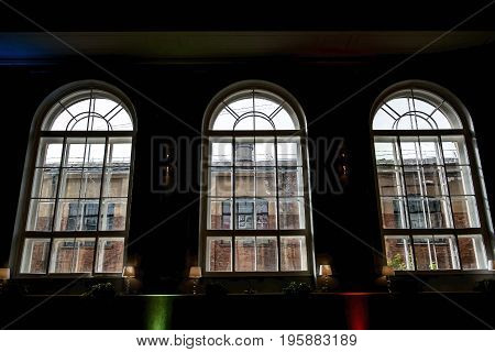 Mystical large arched Windows of a historic building. Ancient room the last time. St Petersburg house - Printing house.