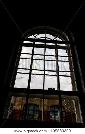 Mystical large arched Window of historic building. Ancient room the last time. St Petersburg house - Printing house.