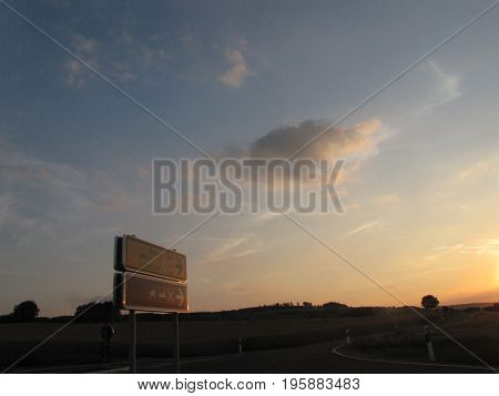 A road in nature at sunset with clear sky It is a wonderful weather