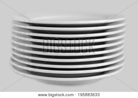 Stack of clean white plates on an isolated background. Cutlery for eating.