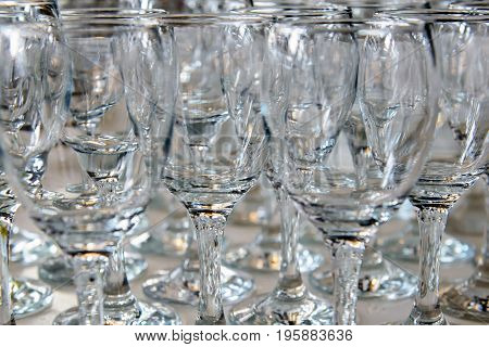 Empty glasses for wine on the holiday table ready to spill alcohol. Serving a formal dining event. Cutlery for people in the restaurant.