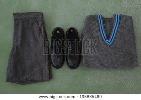 Close-up of school uniform arranged on chalkboard