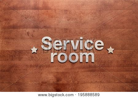Service room is the inscription on a wooden surface