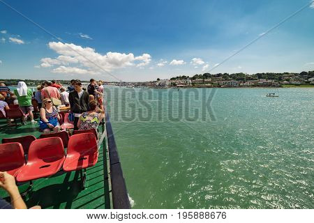 Cowes, UK. 8th July 2017. Passengers are on the top deck of the Red Funnel ferry crossing between Southampton and Cowes on the Isle of Wight on a warm sunny day.