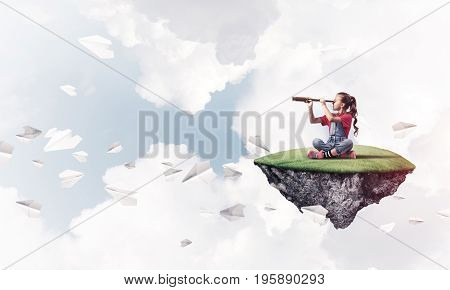 Cute smiling girl with telescope sitting on floating island high in sky