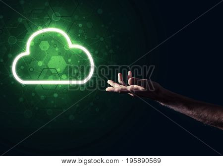 Male hand pointing to the luminous cloud computer concept
