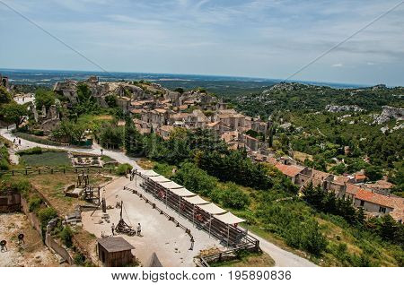 Panoramic view of the Baux-de-Provence castle ruins on the hill, with the roofs of the village just below. Bouches-du-Rhône department, Provence-Alpes-Côte d'Azur region, southeastern France