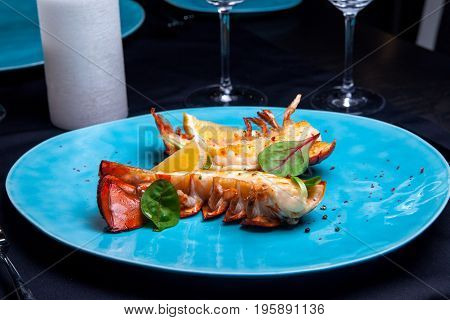 Lobster tail in maple-truffle sauce with lemon and basil