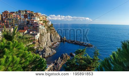 Beautiful panorama view of Manarola town. Is one of five famous colorful villages of Cinque Terre National Park in Italy, suspended between sea and land on sheer cliffs. Liguria region of Italy.