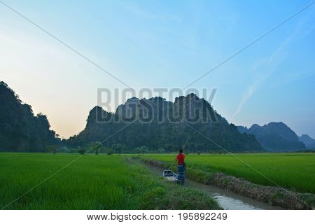 Silhouette Of Burmese Man Floating In The Boat In The Water Channel Leading To Sadan Cave In Hpa-an,