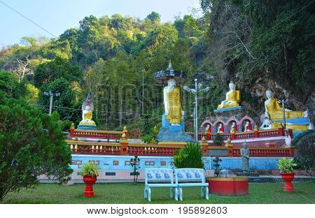 Park with lots of Buddha statues near sacred Kaw Ka Thawng Cave in Hpa-An Myanmar