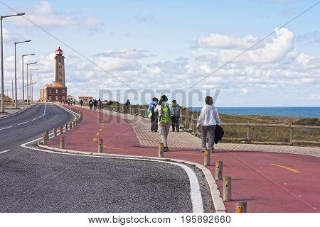 Walk to the lighthouse of Penedo da Saudade in Saint Pedro Moel Portugal