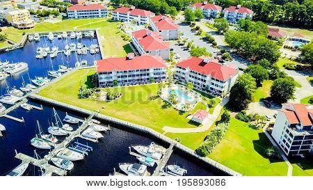 Vacation condominiums next to marina in Myrtle Beach South Carolina. poster