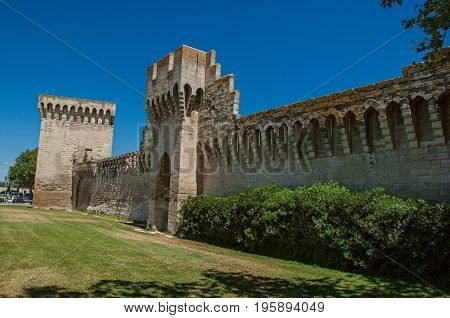 View of the walls and towers around the city center of Avignon, under a sunny blue sky. Located in the Vaucluse department, Provence-Alpes-Côte d'Azur region, southeastern France