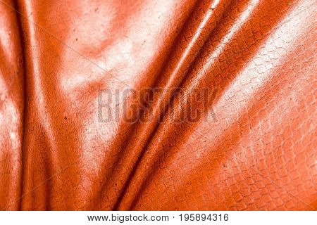 Brown leather material as background. Abstract texture