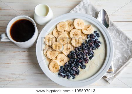 Keywords background banana bowl breakfast cereal closeup coffee cooking cup diet drink eating fitness food fresh fruit grain health healthcare healthy hot kitchen lifestyle meal milk morning natural oat oatmeal organic plate porridge raisins snack spoon s