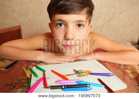 preteen handsome boy with crayons close up photo