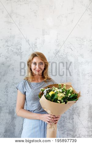 Long-haired florist on empty background