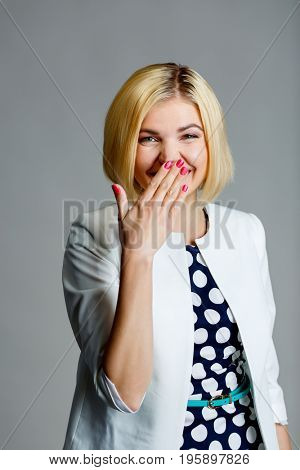 Woman with hand at mouth