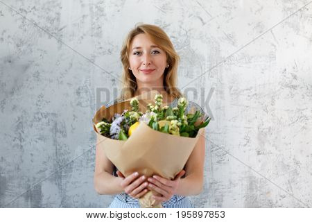 Long-haired blonde on empty background