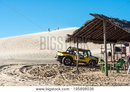 Jericoacoara Ceara state Brazil - July 17 2016: Buggy and moto with tourists traveling through the desert Jericoacoara National Park