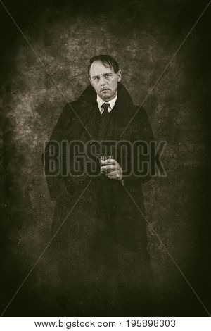Retro 1920S English Gangster Holding Glass Of Whiskey. Peaky Blinders Style.
