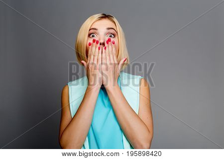 Photo of woman covering face