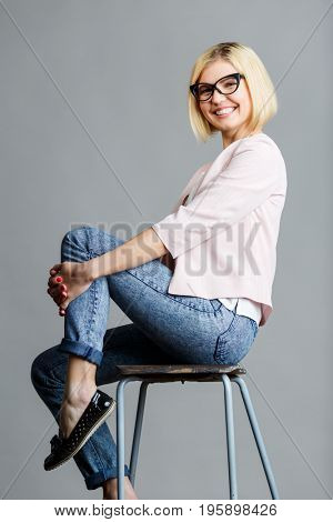 Girl in glasses on chair